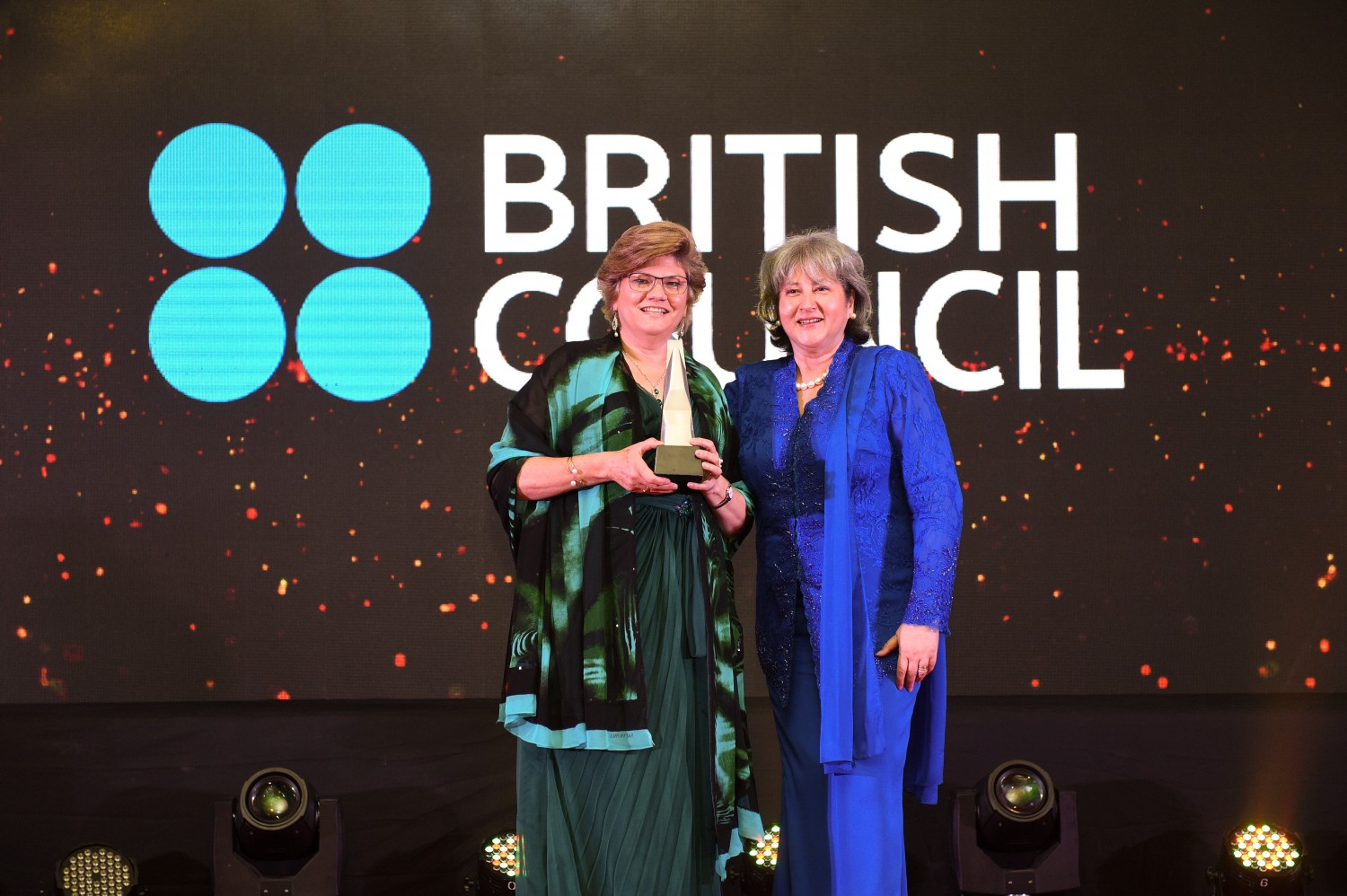 Picture L-R: Sarah Deverall, Country Director of British Council receiving the award from H.E. Vicki Treadell CMG MVO, British High Commissioner to Malaysia