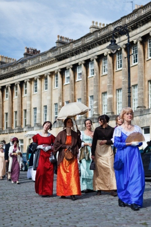 People dressed in period costume for the Jane Austen Festival in Bath (Cr. VisitBritain)