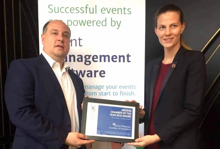 Pictured above, BMCC Executive Director, Aurelia Silva receiving the award from Eric L. Schmidt, CEO of EventBank.