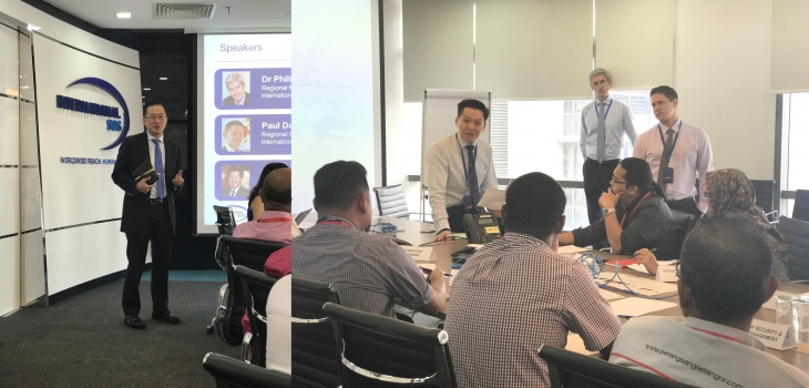 [Left] David Ng, General Manager of International SOS offering a opening speech ahead of the workshop. [Right] Participating medical and security experts exchanging views during the post simulation excercise debrief