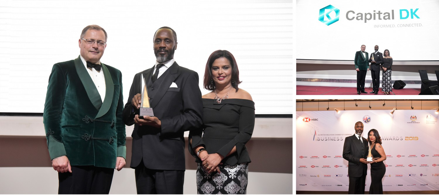 Philip Williamson, CEO & Founder of Capital DK & DK Energy Sdn Bhd receiving the Innovation Award from H.E. Charles Hay, British High Commissioner to Malaysia accompanied by Jennifer Lopez, BMCC Executive Director